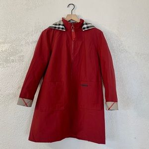 Woman's burgundy zip up jacket with removable hood